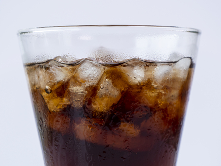 Selective fucus of cola soft drink with ice in the glass on isolated  white background Stock Photo