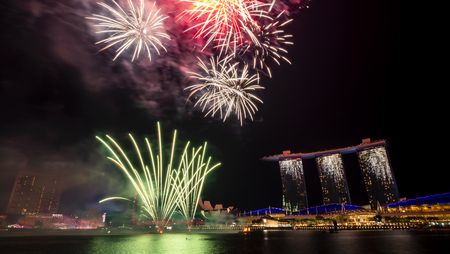 Singapore - Jul 28, 2018 : Firewores of 53 SG Singapore National Day Parade rehearsal dates on Marina Bay at twilight time Editorial