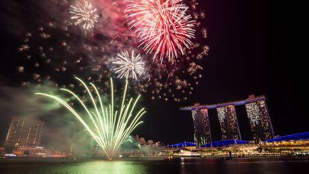 Singapore - Jul 28, 2018 : Firework of 53 SG Singapore National Day Parade rehearsal dates on Marina Bay at twilight time