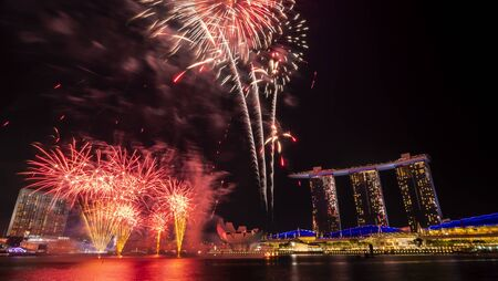 Singapore - Jul 28, 2018 : Marina Bay Sand with Firework of Singapore National Day Parade rehearsal dates (53 SG) at twilight time