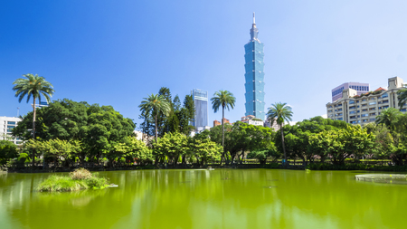Landscape of Taipei city beside the lake in the garden at Zhongshan Park, Taipei with blue sky in the afternoon