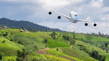 Airplane fly over the beautiful landscape of green paddy field  rice field fram in the afternoon at countryside in Chiangmai, Thailand