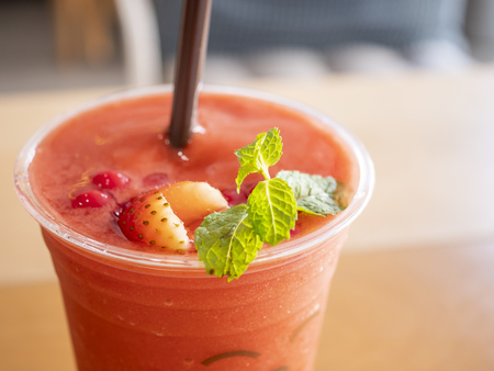 Closeup fresh drink of strawberries smoothie on glass (Selective focus) Stock Photo