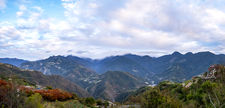 Panorama nature landscape background of mountain view under white cloud and blue sky from Cingjing Farm, Nantou, Taiwan (Switzerland of Taiwan) Stock Photo