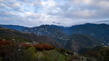 Nature landscape background of mountain view with red and green leafs from Cingjing Farm, Nantou, Taiwan in winter season (Switzerland of Taiwan) Stock Photo