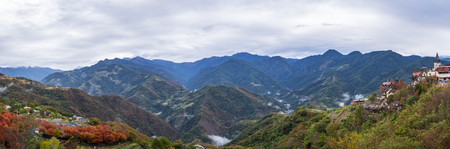 Panorama nature landscape background of mountain view with red and green leafs from Cingjing Farm, Nantou, Taiwan in winter season (Switzerland of Taiwan)