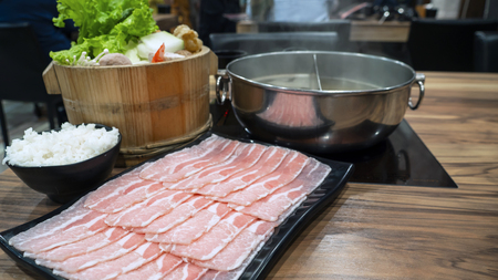 Pork slice, rice and variety vegetable for sukiyaki or hotpot set in the restaurant with selective focus (Taiwan food) 스톡 콘텐츠