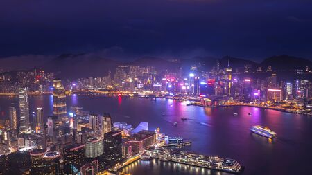 High view of Hong Kong skyline cityscape night light over Victoria harbour 写真素材
