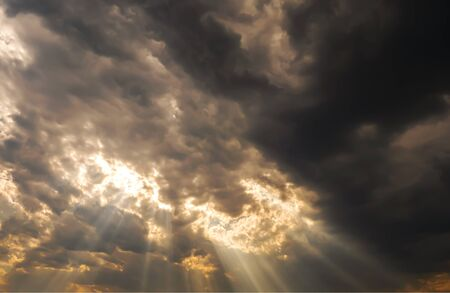 Sunlight in the sky shin over the darkness cloud before big storm coming in the raining season Stock Photo