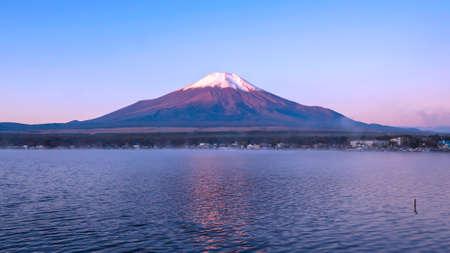 Sunrise landscape of Fuji Mountain with fog in the morning at Yamanaka Lake, Yamanashi, Japan