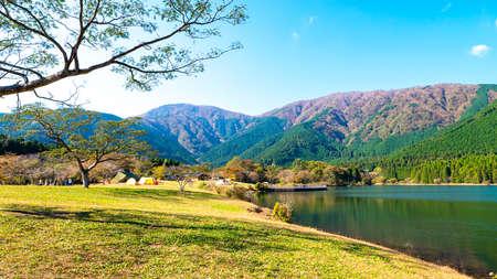 Lake and mountain in winter season over blue sky and cloud at Tanuki Lake, Fujinomiya, Shizuoka Prefecture, Japan