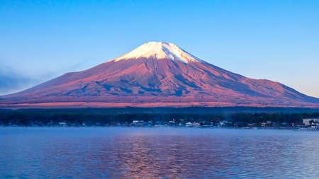 Fuji Mountain with lake and tree over blue sky and cloud at Yamanaka Lake, Yamanashi, Japan 版權商用圖片