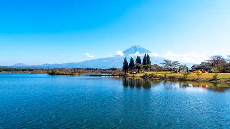 Fuji Mountain with lake and tree over blue sky and cloud at Tanuki Lake, Fujinomiya, Shizuoka Prefecture, Japan