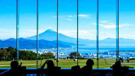 Silhouette view of Mt. Fuji / Fuji Mountain and Shimizu Industrial Port from the window in the restaurant at Nihondaira, Shizuoka, Japan Stock fotó