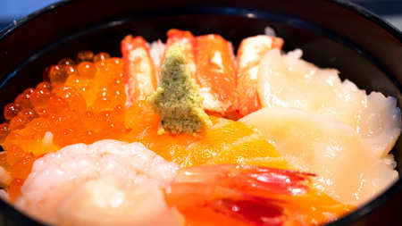 Selective focus of mix sashimi (salmon, crab, shrimp, scallop) in rice bowl, mix sushi donburi in the restaurant (Japanese food) Stock fotó