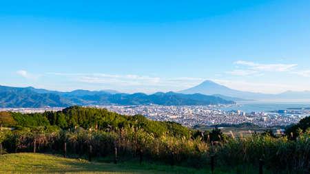 Mt. Fuji / Fuji Mountain and Shimizu Industrial Port over blue sky at Nihondaira, Shizuoka, Japan Stock fotó - 155350766