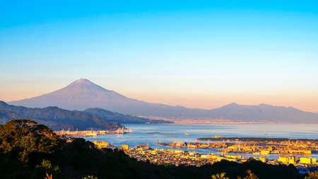 Mt. Fuji / Fuji Mountain and Shimizu Industrial Port over blue sky at Nihondaira, Shizuoka, Japan