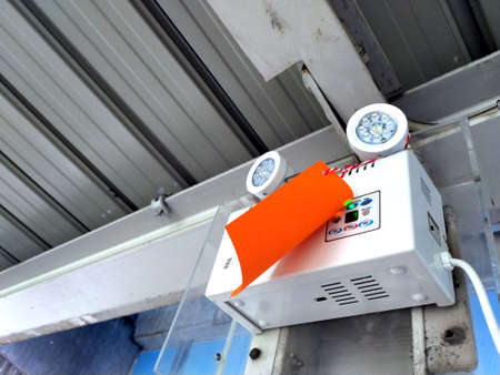 Emergency light at overpass outside, have maintenance label attach to it.