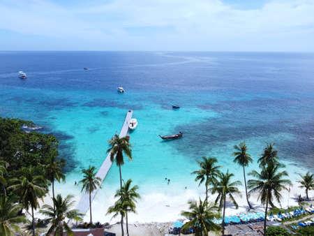 Aerial view of coast beach, green blue sea, blue sky - Koh Hey island, Phuket province, Thailand.