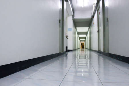 Perspective low angle view of corridor, hallway or walkway of apartment, condominium. For rental. Stock Photo