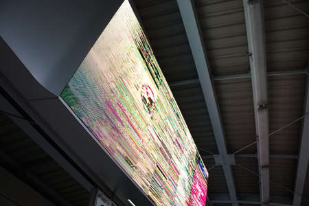 Broken LED advertisement panel screen. Show distortion image. Billboard on sky train. Side view.