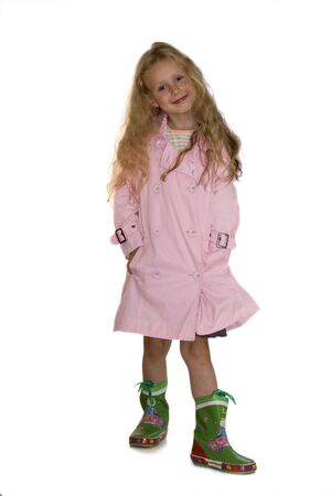 Five years girl wearing pink coat and green boots.