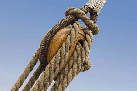 Natural fibre ropes, rigging, block and tackle on a wooden sailing ship