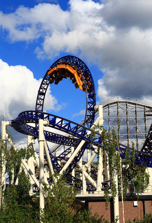 Steel Roller Coaster in front and wooden in background in a greatest amusement park in Scandinavia - Liseberg