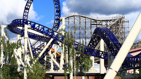 inverted: Steel Roller Coaster in front and wooden in background in a greatest amusement park in Scandinavia - Liseberg