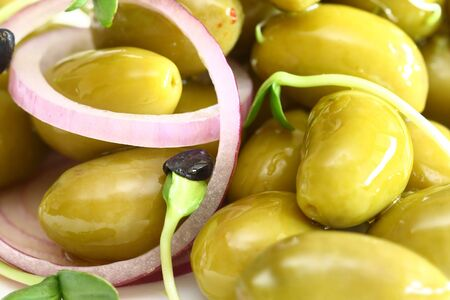 Oily olive with onion and sunflowers sprout