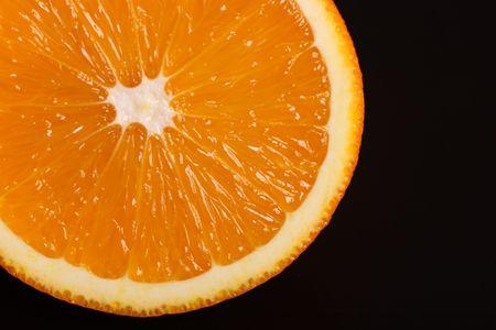 Fresh orange isolated on black
