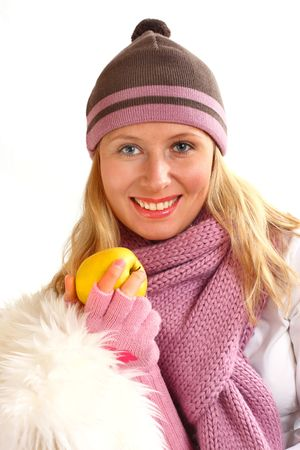 Young beautiful blond girl, eating apple on the white background photo