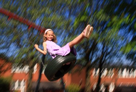 Young girl swinging (motion blur) Stock Photo