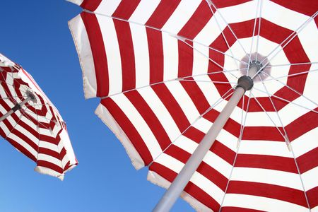 beach umbrella: This simple picture clearly represents concept of holidaysvacations Stock Photo