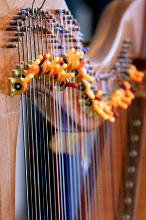 A part of old handmade harp with multicolor strings Stock Photo