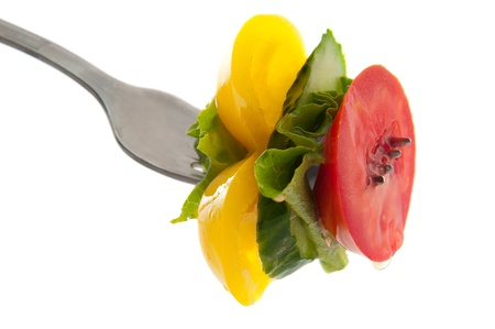 fork with fresh vegetables and oil drops Stock Photo