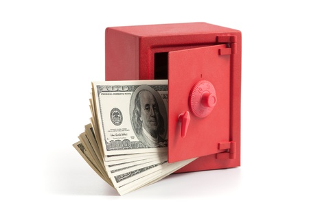 little red safe with the door open and a stack of dollar bills photo