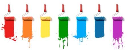 七色の塗料でローラのブラシ 写真素材
