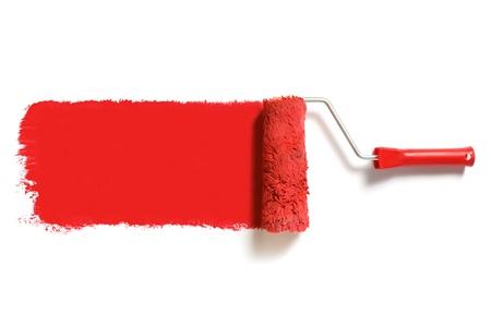 roller: cepillo de pintura roja Foto de archivo