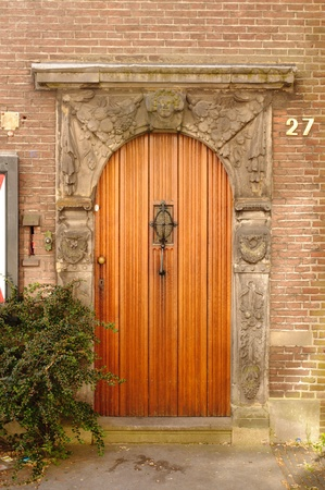 front entry: architectural detail of entrance with door