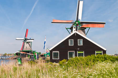 Traditional Old Windmill in Zaanse Schans, Netherlands photo
