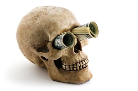 skull with money on white background Stock Photo