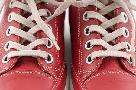 red shoes: red leather sneakers on white