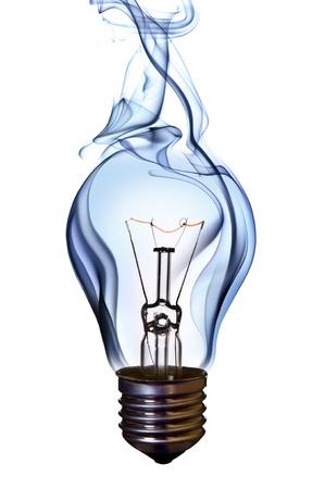 magical equipment: blue smoke lamp bulb art concept on white Stock Photo