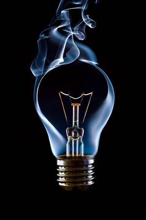 blue smoke lamp bulb art concept on black photo