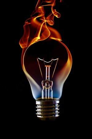 fire smoke lamp bulb art concept on black photo