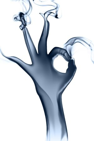 Smoke hand with OK sign on white Standard-Bild