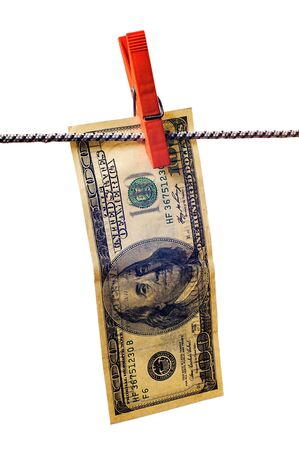 drying dollar with clothespin on cord on white background photo