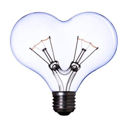 blue heart shape lamp bulb on white background photo