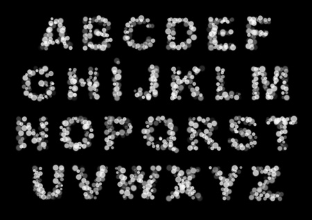 abstract light latin alphabet letters monocolor on black photo